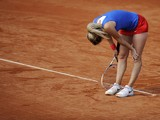 Czech Republic's Klara Zakopalova reacts to play after missing a point against Spain's Carla Suarez Navarro during their 2014 International Tennis Federation Fed Cup World Group first-round tie at the Blas Infante tennis centre in Sevilla on February 10,