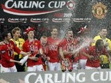 Manchester United players celebrate winning the League Cup on March 1, 2009.