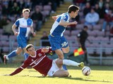 Tom Lockyer of Bristol Rovers attempts to move away from the challenge of Brennan Dickenson of Northampton Town during the Sky Bet League Two match between Bristol Rovers and Northampton Town at Sixfields Stadium on March 1, 2014