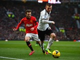 Ryan Tunnicliffe of Fulham competes with Juan Mata of Manchester United during the Barclays Premier League match between Manchester United and Fulham at Old Trafford on February 9, 2014