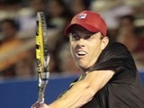 Sam Querrey of USA returns the ball to Tigre Hank of Mexico during the Mexico ATP Open men's single tennis match, in Acapulco, Guerrero state, Mexico on February 24, 2014