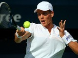 Tomas Berdych returns the ball to Marius Copil during their match in the ATP Dubai Duty Free Tennis Championships on February 25, 2014
