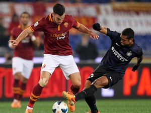 Kevin Strootman of AS Roma competes for the ball with Guarin of FC Internazionale Milano during the Serie A match between AS Roma and FC Internazionale Milano at Stadio Olimpico on March 1, 2014