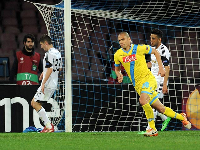 Napoli's Gokhan Inler celebrates after scoring his team's third goal against Swansea during their Europa League match on February 27, 2014