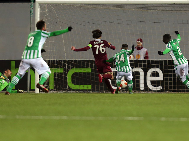 Real Betis' players celebrate after scoring a goal against Rubin Kazan during their Europa League match on February 27, 2014