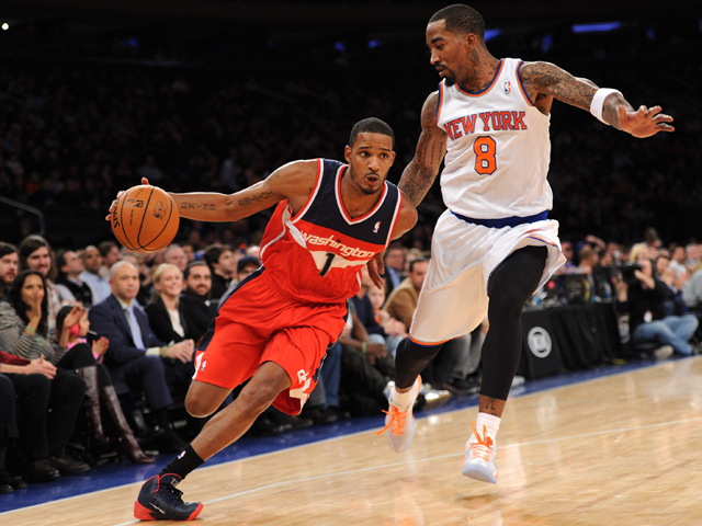 Trevor Ariza #1 of the Washington Wizards drives against J.R. Smith #8 of the New York Knicks during the first quarter at Madison Square Garden on December 16, 2013