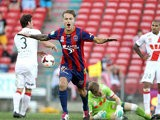 Newcastle Jets' Adam Taggart celebrates after scoring the opening goal against Melbourne Heart during their A-League match on March 8, 2014