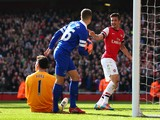 Olivier Giroud of Arsenal celebrates after scoring his team's third goal during the FA Cup Quarter-Final match between Arsenal and Everton at Emirates Stadium on March 8, 2014
