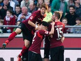 Hannover's Artjoms Rudnevs celebrates with teammates after scoring the equaliser against Bayer Leverkusen during their Bundesliga match on March 8, 2014