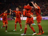 Marouane Fellaini #8 of Belgium is congratulated by tema mates after he scores the first goal of the game during the International Friendly match between Belgium and Ivory Coast at The King Baudouin Stadium on March 5, 2014