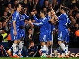 Chelsea's Demba Ba celebrates with teammates after scoring his team's fourth goal against Tottenham during their Premier League match on March 8, 2014