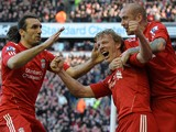Liverpool's Dutch forward Dirk Kuyt celebrates with Liverpool's Portuguese midfielder Raul Meireles and Liverpool's Greek defender Sotirios Kyrgiakos after scoring his third goal during the English Premier League football match between Liverpool and Manch
