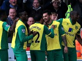 Bradley Johnson of Norwich is congratulated by teammates after scoring the opening goal during the Barclays Premier League match between Norwich and Stoke at Carrow Road on March 8, 2014