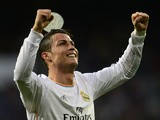 Real Madrid's Portuguese forward Cristiano Ronaldo celebrates after scoring their first goal during the Spanish league football match Real Madrid CF vs Levante UD at the Santiago Bernabeu stadium in Madrid on March 9, 2014