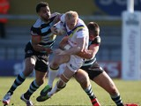 Warrington's Rhys Evans is tackled during the Super League match against London Broncos on March 9, 2014