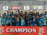 Sri Lanka cricketers celebrate with the trophy after winning the final match of the Asia Cup one-day cricket tournament against Pakistan on March 8, 2014