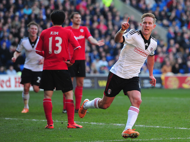 Lewis Holtby of Fulham celebrates after scoring the first Fulham goal during the Barclays Premier league match between Cardiff City and Fulham at Cardiff City Stadium on March 8, 2014