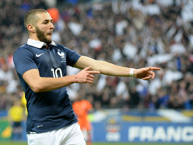 France's forward Karim Benzema celebrates after scoring the first goal during a friendly football match between France and Netherlands at the Stade de France in Saint-Denis near Paris on March 5, 2014