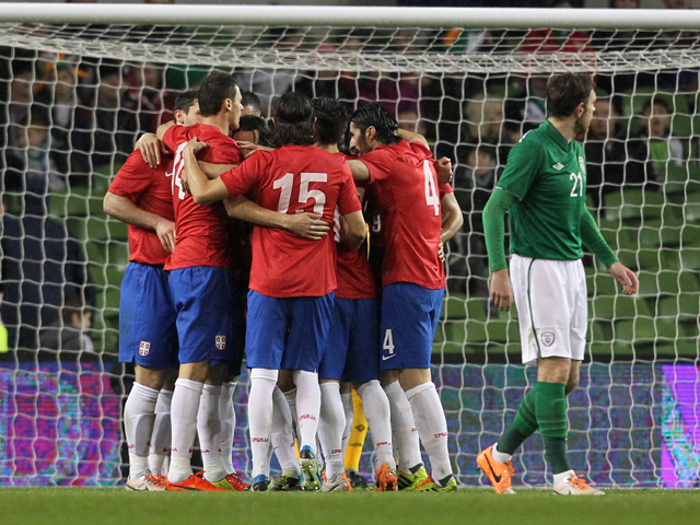 Serbia players celebrate their first goal during the international friendly football match between the Republic of Ireland and Serbia at Aviva Stadium in Dublin on March 5, 2014