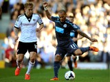 Yoan Gouffran of Newcastle controls the ball as Lewis Holtby of Fulham closes in during the Barclays Premier league match between Fulham and Newcastle United at Craven Cottage on March 15, 2014