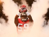 Joplo Bartu #59 of the Atlanta Falcons runs out during player introductions prior to playing against the Tampa Bay Buccaneers on October 20, 2013