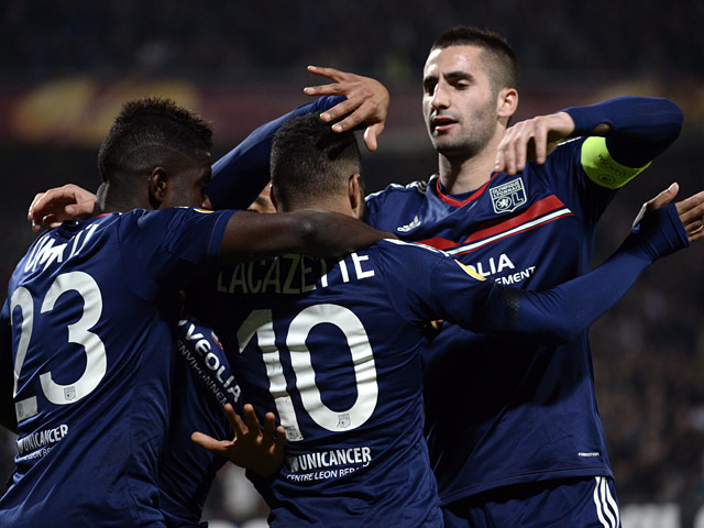 Lyon's Alexandre Lacazette is congratulated by teammates after scoring against Viktoria Plzen during their Europa League match on March 13, 2014