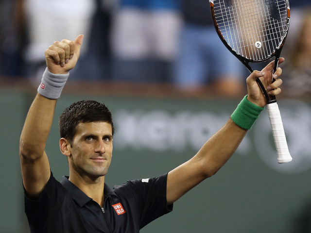 Novak Djokovic of Serbia acknowledges the fans following his victory over Victor Hanescu of Romania during the BNP Paribas Open at Indian Wells Tennis Garden on March 9, 2014