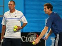 Andy Murray of Great Britain serves as his coach Ivan Lendl looks on during training on day 10 of the 2013 Australian Open on January 23, 2013