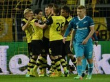 Dortmund´s players celebrate after scoring during the last 16 second-leg UEFA Champions League football match Borussia Dortmund vs Zenit St Petersburg in Dortmund, western Germany on March 19, 2014