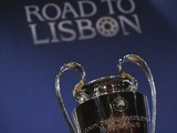 The UEFA Champions League trophy is displayed prior to the UEFA Champions League 2013/14 season quarter-finals draw at the UEFA headquarters, The House of European Football, on March 21, 2014