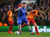 Frank Lampard of Chelsea evades Selcuk Inan of Galatasaray during the UEFA Champions League Round of 16 second leg match on March 18, 2014