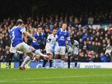 Leighton Baines of Everton scores from the penalty spot during the Barclays Premier League match between Everton and Swansea City at Goodison Park on March 22, 2014