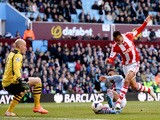 Peter Odemwingie of Stoke shoots past goalkeeper Brad Guzan of Aston Villa to score a goal during the Barclays Premier League match on March 23, 2014