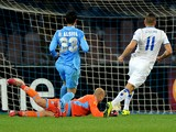 Nabil Ghilas of FC Porto scores their first goal during the UEFA Europa League Round of 16 match between SSC Napoli and FC Porto at Stadio San Paolo on March 20, 2014