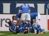Schalke's players celebrate after scoring during the German first division Bundesliga football match against Eintracht Braunschweig on March 22, 2014