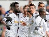 Wilfried Bony of Swansea City celebrates his goal with team mates during the Barclays Premier League match against Everton on March 22, 2014
