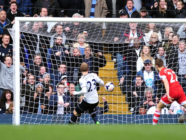 Tottenham Hotspur's Danish midfielder Christian Eriksen (L) scores his team's second goal during the English Premier League football match against Southampton on March 23, 2014