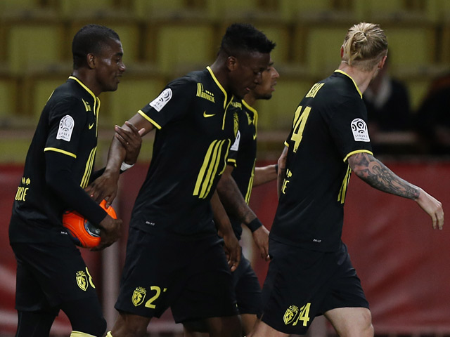 Lille's Divock Origi celebrates with teammates after scoring his team's first goal against Monaco in the Ligue 1 match on March 23, 2014