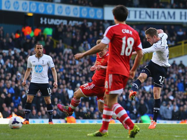 Gylfi Sigurdsson of Tottenham Hotspur scores his team's third goal during the Barclays Premier League match against Southampton on March 23, 2014