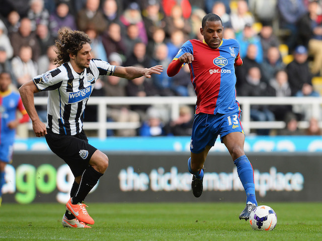 Jason Puncheon of Crystal Palace takes on Fabrizio Coloccini of Newcastle United during the Barclays Premier League match on March 22, 2014