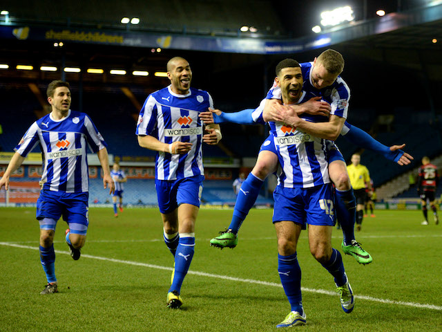 Leon Best of Sheffield Wednesday celebrates scoring to make it 2-0 with team mates during the Sky Bet Championship match between Sheffield Wednesday and QPR on March 18, 2014