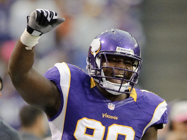 Letroy Guion #98 of the Minnesota Vikings celebrates during the game against the Tennessee Titans on October 7, 2012