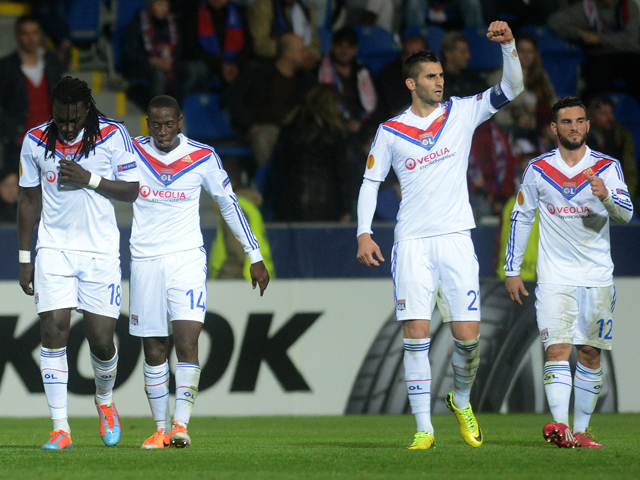Lyon's French forward Bafetimbi Gomis, defender Mouhamadou Dabo, midfielder Maxime Gonalons Lyon's and midfielder Jordan Ferri celebrate during the last 16 second-leg UEFA Europa League football match FC Viktoria Plzen vs Olympique Lyonnais on March 20, 2