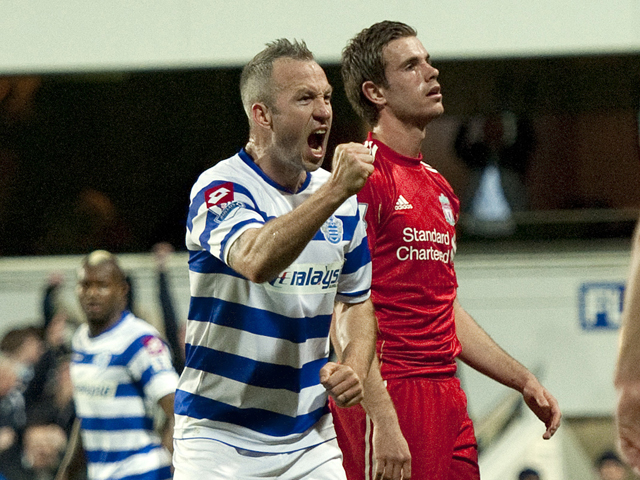 Queens Park Rangers' English midfielder Shaun Derry celebrates scoring his goal during the English Premier League football match between Queens Park Rangers and Liverpool at Loftus Road in London, England on March 21, 2012
