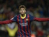 Barcelona's Brazilian forward Neymar da Silva Santos Junior celebrates after scoring during the Spanish league football match FC Barcelona vs RC Celta de Vigo at the Camp Nou stadium in Barcelona on March 26, 2014