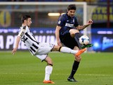 Andrea Ranocchia of FC Inter Milan and Bruno Fernandes of Udinese Calcio (L) compete for the ball during the Serie A match on March 27, 2014