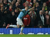 Manchester City's Bosnian forward Edin Dzeko celebrates after scoring the opening goal during the English Premier League football match between Manchester United and Manchester City at Old Trafford in Manchester on March 25, 2014