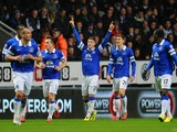 Ross Barkley of Everton celebrates scoring the pening goal with team mates during the Barclays Premier League match between Newcastle United and Everton at St James' Park on March 25, 2014