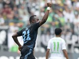 Hamburg's Cameroonian defender Jacques Zoua celebrates during the German first division Bundesliga football match Borussia Monchengladbach vs Hamburger SV in the German city of Monchengladbach on March 30, 2014
