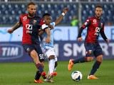 Ogenyi Eddy Onazi of SS Lazio competes for the ball with Daniele Portanova of Genoa CFC during the Serie A match between Genoa CFC and SS Lazio at Stadio Luigi Ferraris on March 26, 2014
